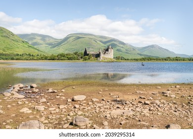 Argyll And Bute, Scotland - July 15 2021; Kilchurn Castle on the edge of Loch Awe including the hills behind