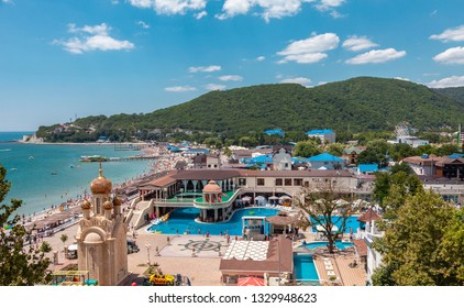 Arhipo-Osiovka, Russia - July 5, 2018: Beautiful landscape of Black Sea resort. People relax and have fun in the entertainment area and pool.