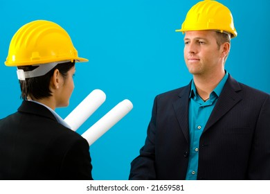 Arhitects shaking hands isolated on blue background.