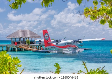 Ari Atoll, Maldives - 05.05.2018: Maldives seaplane on luxury resort, wooden jetty loading the plane, ready for departure. Tropical island background, travel and tourism concept in Maldives island