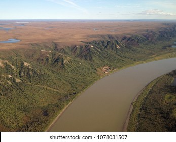 Arial of the Mackenzie River in the fall carving its way through the tundra on its way to the Arctic Ocean. North of Inuvik, Northwest Territories, Canada.