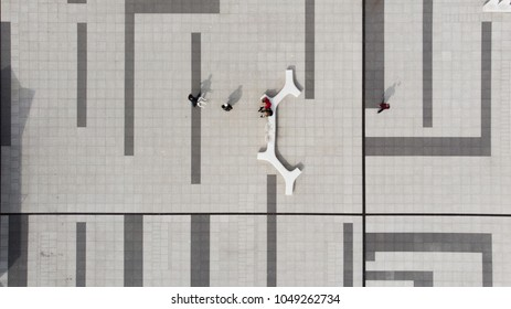 Arial shoot of patters on ground while people walking