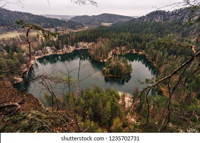 Arial or top view of Adrspach sandstone rock city and an Adrspach lake. Famous nature protected area of sandstone towers, Adrspach, nothern Bohemia, Czech Republic.