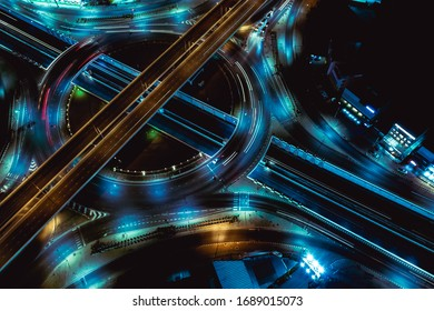 Arial top view of Modern transportation with Expressway, Road and Roundabout,Road traffic, multilevel junction highway-Top view in  asia. Important infrastructure for transport.
