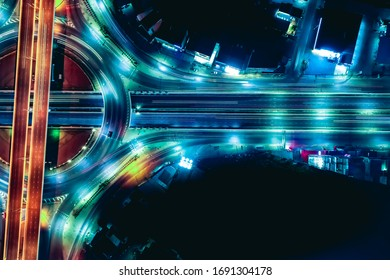 Arial top view of Modern transportation with Expressway, Road and Roundabout,  Road traffic, multilevel junction highway-Top view. Important infrastructure and transport in big city, Bangkok Thailand.