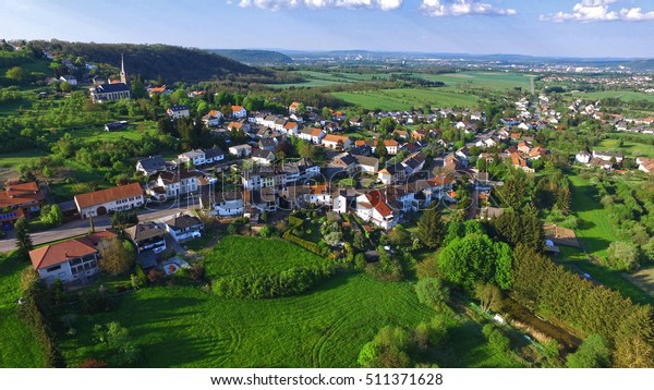 Arial view above a german village green view