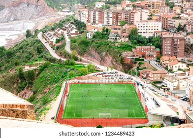 Arial view of the city and  football field. People enjoying sports outdoors. Cardona. Spain.