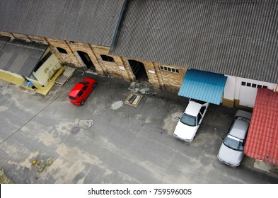 Arial view of a godown building and vehicles at a depot.
