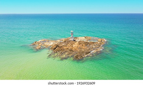 The arial view of lighthouse on the rock on Khao Lak beach,Phang Nga,Thailand.