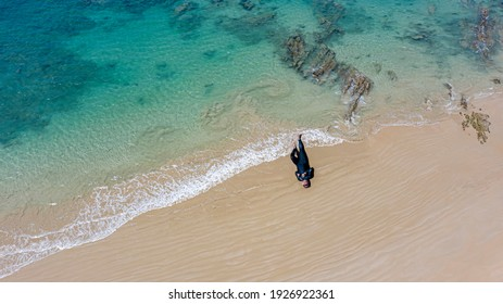Arial view a man lying on the khao Lak beach,pohang Nga,Thailand.