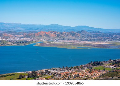 The arial view of the mountains of Lake Elsinore, CA featuring the Super Bloom of California Poppies and wildflowers.