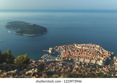 Arial view overlooking Dubrovnik Old Town and Otok Lokrum (Lokrum Island) taken from top of Mount Srd, Croatia