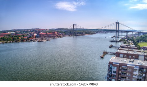 "Arial view at the Suspension bridge named ""Älvsborgsbron"" with surrounding buildings in Gothenburg, Sweden."