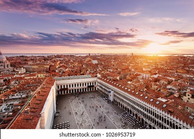 Arial view of Venice with San Marco Square and homes at sunset. Venice, Italy.
