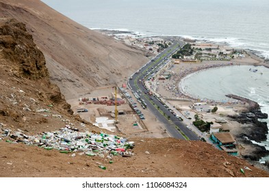 ARICA, CHILE, 2017-01-26: view to the trash in the desert in mountains and highway and beach at the background