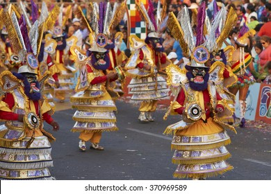 ARICA, CHILE - JANUARY 22, 2016: Morenada dance group  in traditional Andean costume performing at the annual Carnaval Andino con la Fuerza del Sol in Arica, Chile.