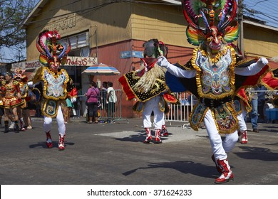 ARICA, CHILE - JANUARY 22, 2016: Masked members of a Diablada dance group performing as part of the Carnaval Andino con la Fuerza del Sol in Arica, Chile. The dance originates in Oruro, Bolivia