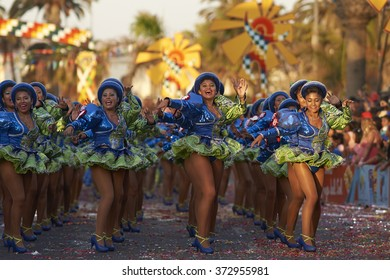ARICA, CHILE - JANUARY 23, 2016: Female members of a Caporales dance group in ornate green and blue costumes performing at the annual Carnaval Andino con la Fuerza del Sol in Arica, Chile.