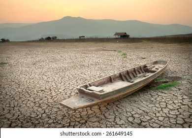 Arid climate, Drought at the lake with wooden boat