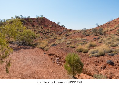 Arid landscape, erosion and spinifex grass at Lark Quarry, the location of the dinosaur stampede, in rural Queensland, Australia