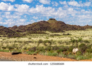 The arid landscape of the Karoo National Park in South Africa.