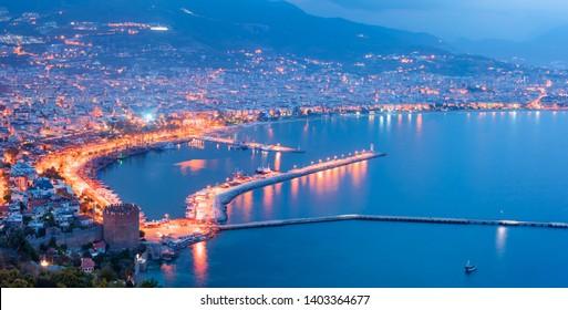 Ariel view of Alanya harbor from Alanya peninsula. Turkish Riviera by night