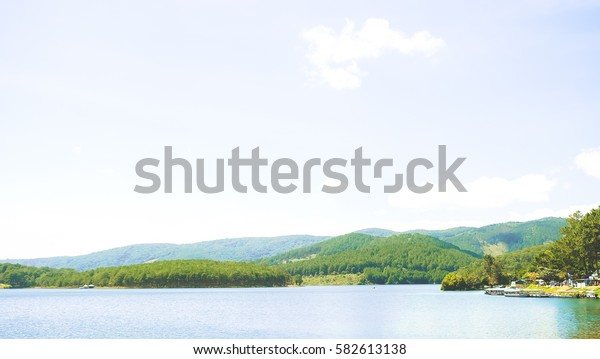 Ariel View of Beautiful Lake, Blue Sky, Green Forest