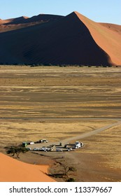 Ariel view of cars parked in Sossusvlei, Nambia, taken from the ridge of Dune 45