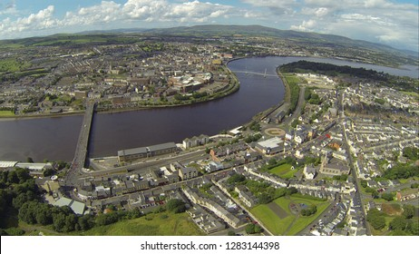 Ariel view of Derry Londonderry Northern Ireland with the craigavon and peace bridge over looking the river foyle on the 12th of August parades