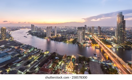 Ariel view of downtown Bangkok skyline from roof top at sunset