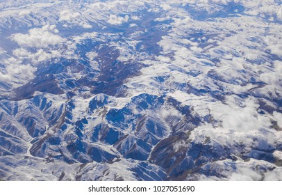Ariel view of Himalayan Mountain, Spring landscape. Mountains with altitude in blue distance, plexus of mountains.