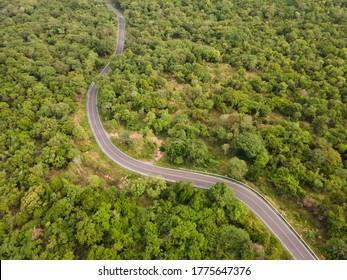 Ariel view road on mountain pass forest