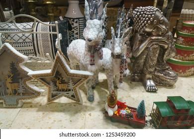 Arinaga, Gran Canaria / Spain - November 22 2018: New Year composition in the window of the shop - reindeer, stars, train, fir