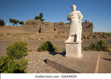 Aristotle statue in front of Assos ancient city where he lived three years Turkey