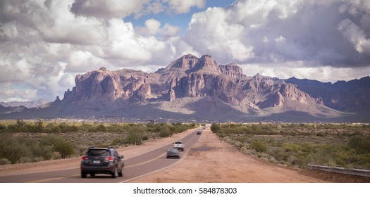 Arizona desert road leading to Superstition Mountain near Phoenix,Az,USA