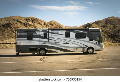 ARIZONA - OCTOBER 31, 2017: Self-propelled recreational vehicle parking in the desert.   RV offers accommodation combined with a vehicle engine and is a common way to tour the US from coast to coast.