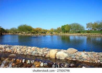 Arizona Pond and Desert, with a blue sky; in horizontal orientation