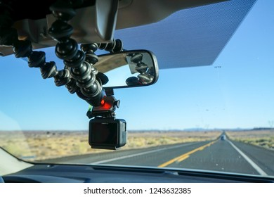 ARIZONA, UNITED STATES OF AMERICA - MAY 19, 2018: GoPro Hero 5 Black action camera hanging on a car mirror with a Joby GorillaPod.