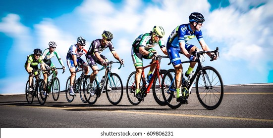 Arizona, United States, March 25, 2017: North End Classic? Weldon Road Race, Day 2 of 3, Triathlete Event. Group Of Male Cyclist Contestants Racing Near Yuma, Arizona