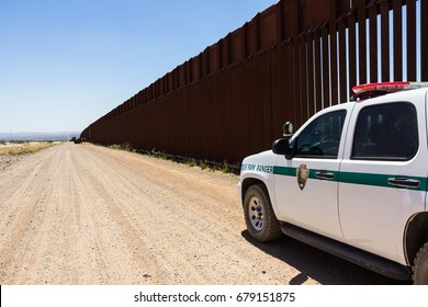 Arizona, USA - June 28, 2016: Police car stopped near the border fence of the USA .