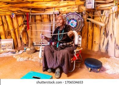 ARIZONA, USA - MARCH 29, 2020: Old Navajo woman in Navajo nation reservation at Monument Valley, Arizona, USA