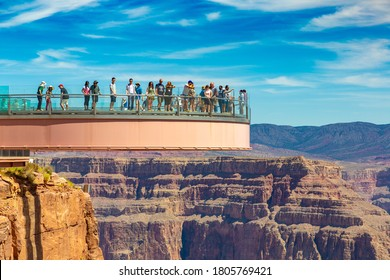 ARIZONA, USA - MARCH 29, 2020: Tourist enjoying the view at Grand Canyon Skywalk observation point at Grand Canyon West Rim in a sunny day, Arizona, USA