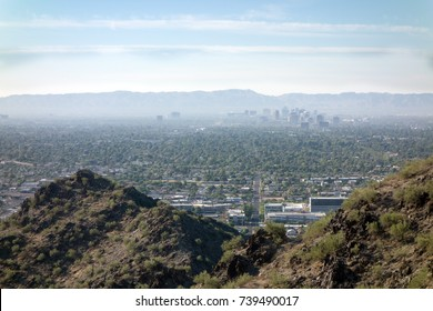 Arizona Valley of the Sun or Greater Phoenix Metro area as seen from North Mountain Park hiking trails on cool October morning