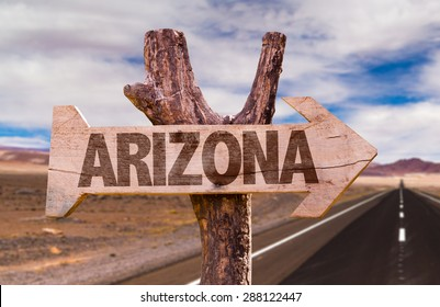 Arizona wooden sign with desert road background
