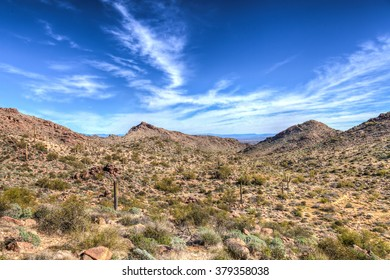 Arizona-Waddell-White Tank Mountain Regional Park. The Mesquite Trail exhibits spectacular saguaros, gorgeous desert, and mountains that surround one at all angles.