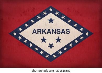 Arkansas flag on fabric texture,retro vintage style