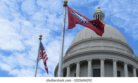 Arkansas State Capitol building cupola (dome) with US flag and Arkansas state flag
