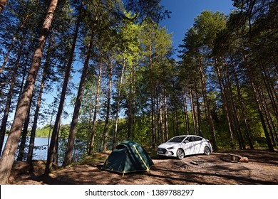 Arkhangelsk region, Russia - May 2018: A car and a tent against the backdrop of a forest clearing in spring. Outdoor activities
