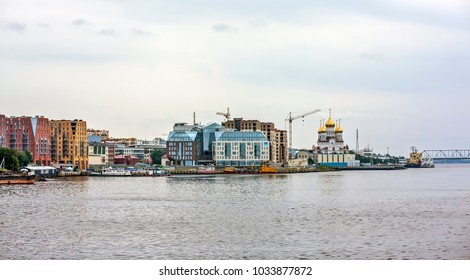ARKHANGELSK, RUSSIA - AUGUST 20, 2017: Photo of Modern houses on the banks of the Northern Dvina
