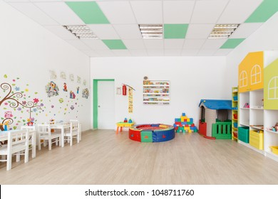 Arkhangelsk, Russia - march 3, 2018: Bright Interior of a modern kindergarten in yellow and green colors. Natural day light.